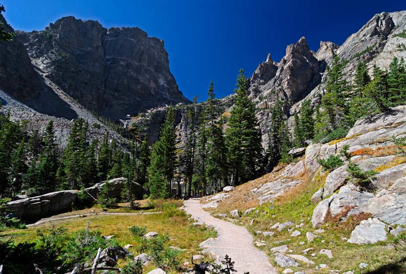 trail leading through grey crags on emerald lake hike in rocky mountain national park