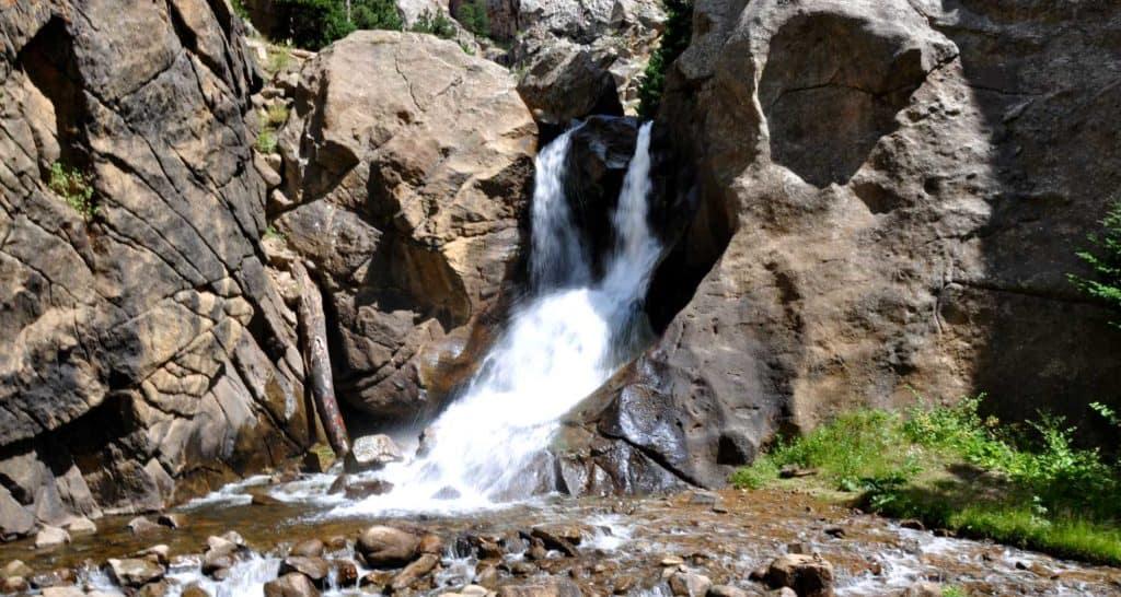 boulder falls waterfall near boulder colorado pouring through canyon into creek below with grey rock cliffs