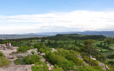 view from daniels park bluff toward front range mountains on hike near denver