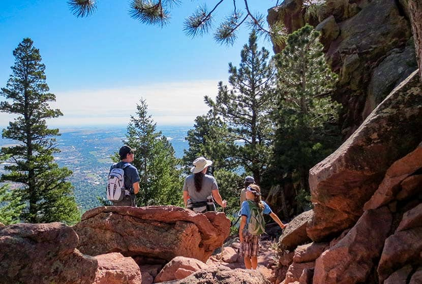 family resting on hike between first and second flatiron in boulder colorado