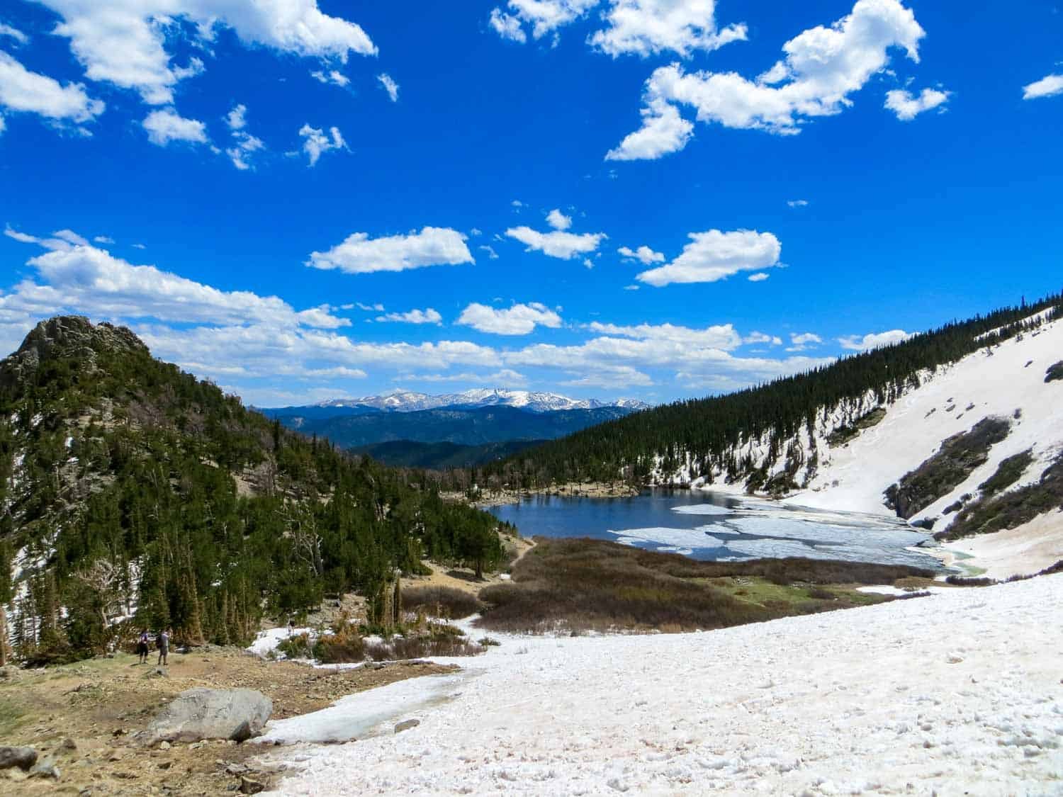 st marys glacier near idaho springs colorado header with snowcapped mountains in background