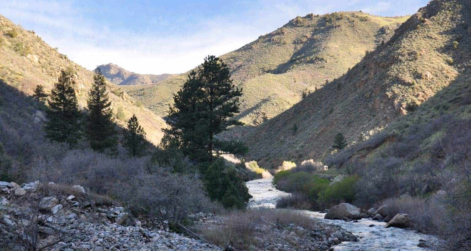 south platte river flowing through waterton canyon with foothills in background hikes near denver