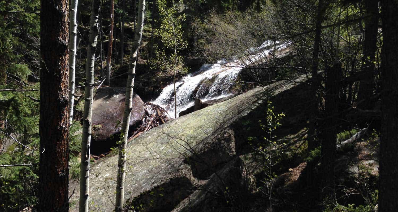 buffalo creek waterfall at wellington lake slide waterfall cascading over granite slab on hike near denver