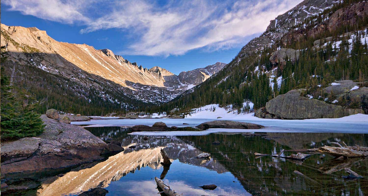 reflection of keyboard of the winds in mills lake in rocky mountain national park