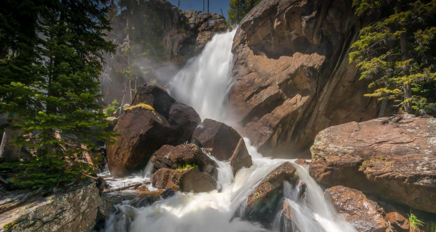 ouzel falls waterfall in background with cascades in foreground in rocky mountain national park