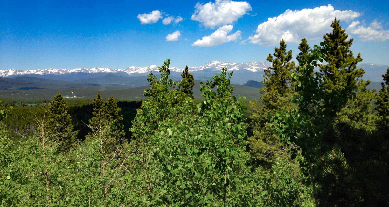 snow capped front range mountains of colorado from panorama at golden gate canyon state park along raccoon trail hike