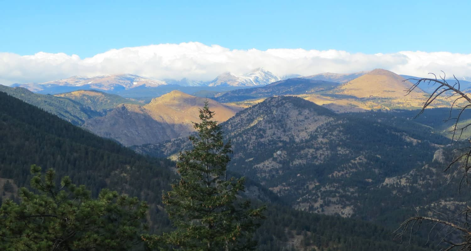 realization point view to front range snow capped mountains on hike near boulder colorado