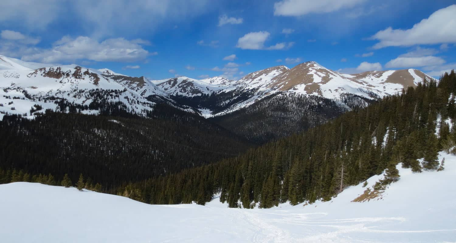 view from snow covered meadow of front range colorado mountains in butler gulch colorado