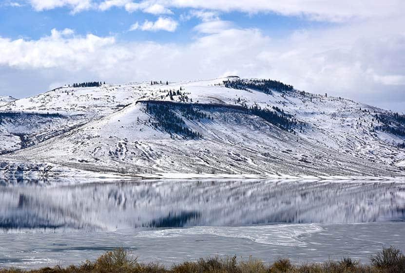 10 winter hiking tips mountain reflection