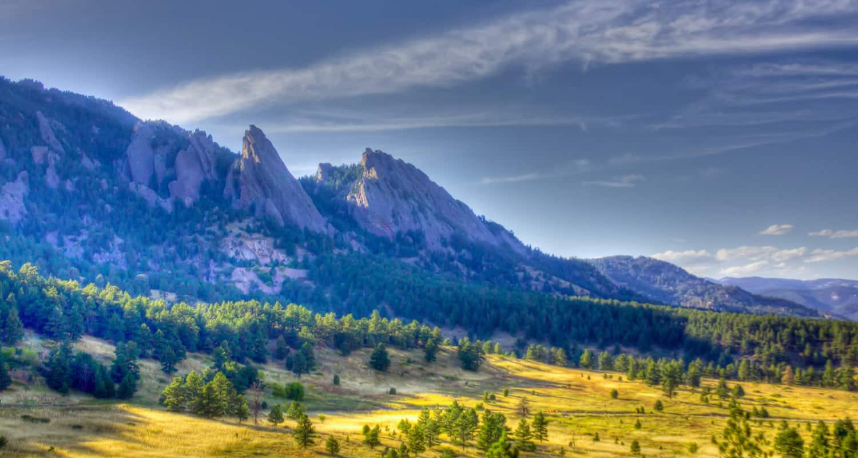 morning light on flatirons mountains near boulder taken from ncar on bear canyon loop hike