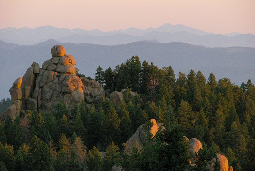 Rock formations in foreground and Longs peak in background at Devils Head Lookout firetower south of Denver Colorado