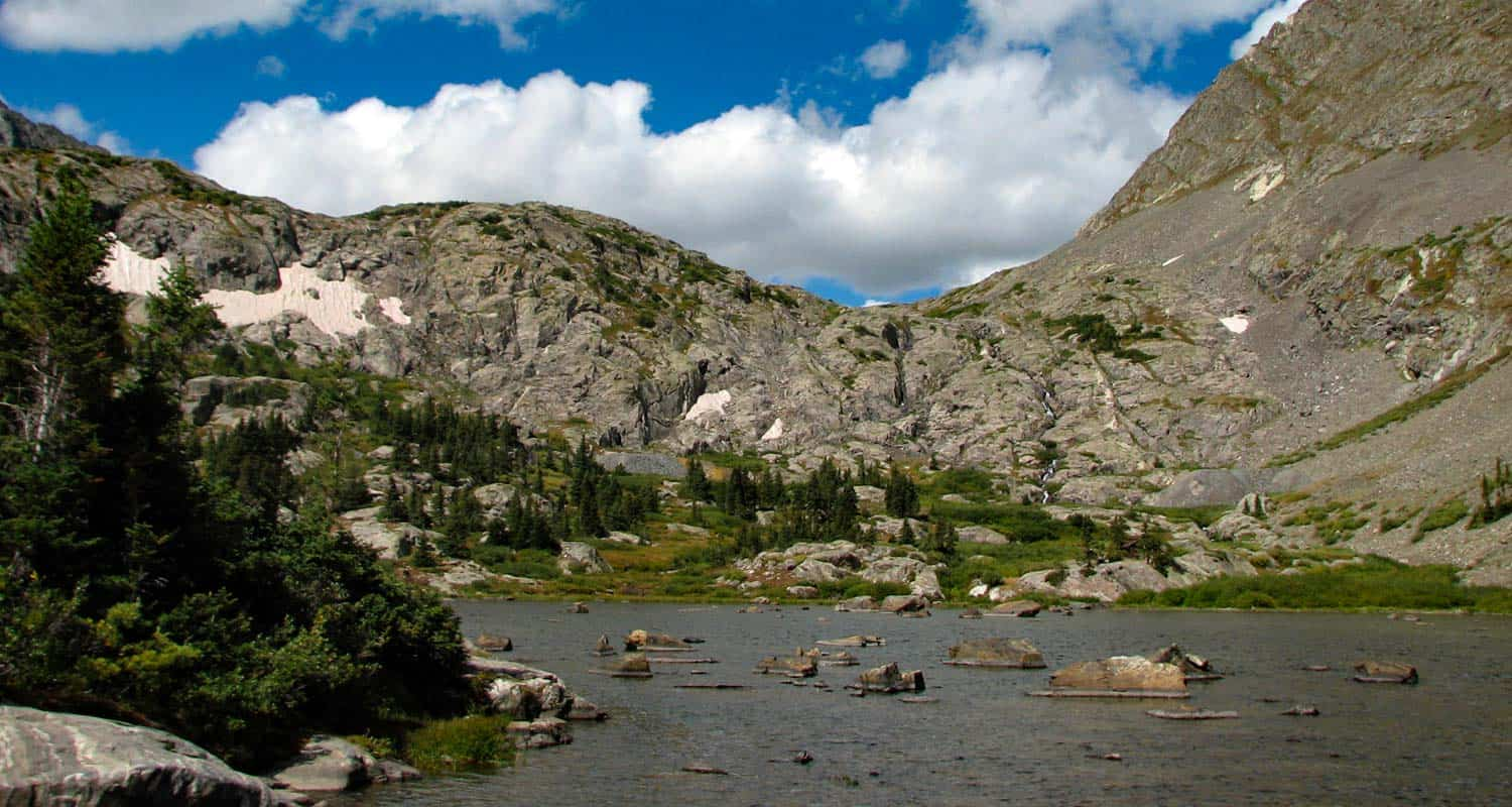 mohawk lake with grey mountain faces in background on mohawk lakes hike near breckenridge colorado