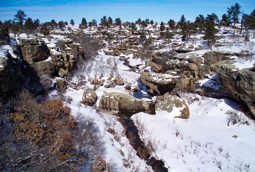 cherry creek flowing through winter landscape of castlewood canyon winter hike near denver