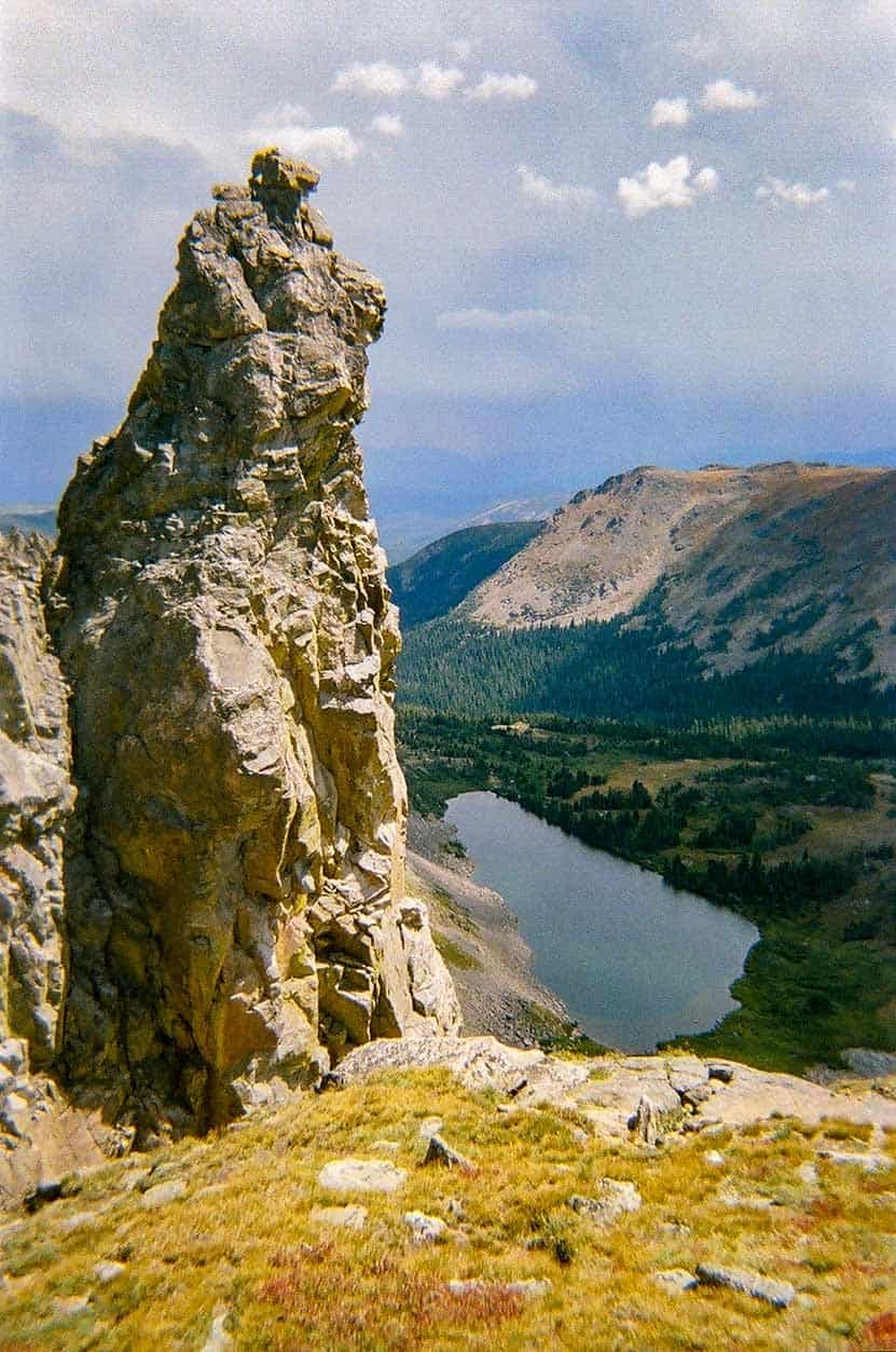Devils Thumb Rock formation from ridgeline looking down on devils thumb lake colorado