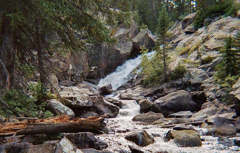 waterfall through rocks of middle boulder creek near lost lake in indian peaks wilderness