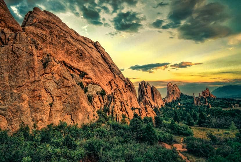 Garden of the Gods red rock in colorado springs with sunset and cloudy skies