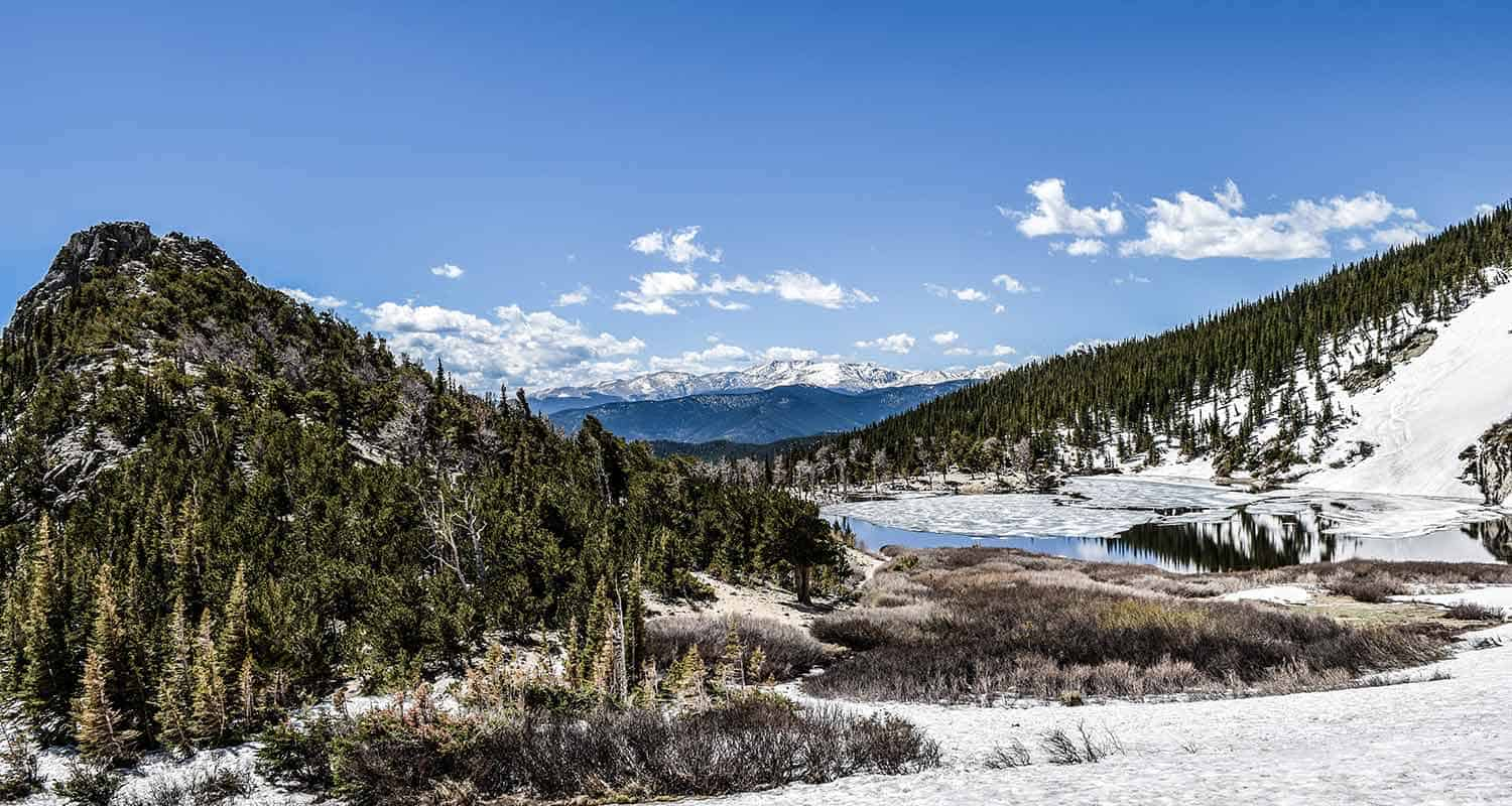 view across st marys lake near denver to snowcapped mountains and glacier