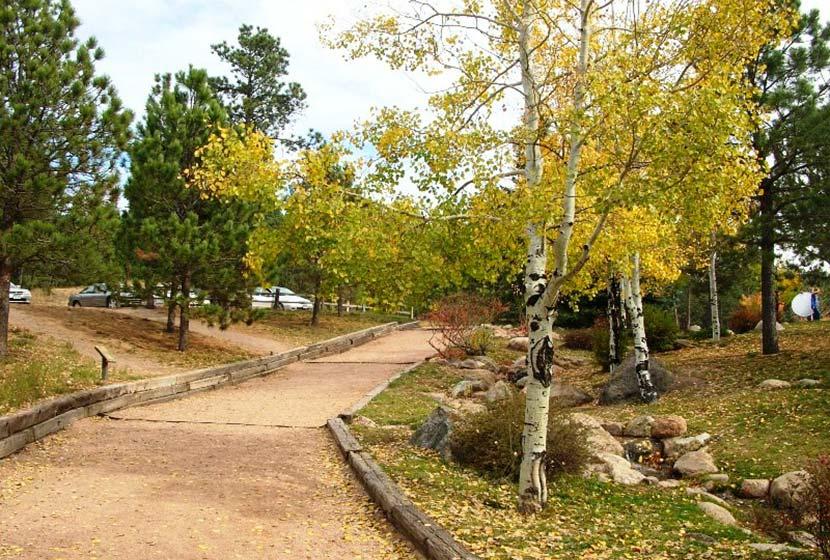 parking area near lake with aspen tree along trail at fox run park near colorado springs