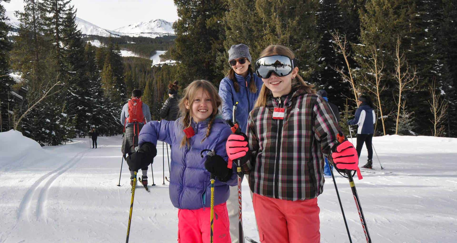 family learning to cross country ski at the breckenridge nordic center in Colorado