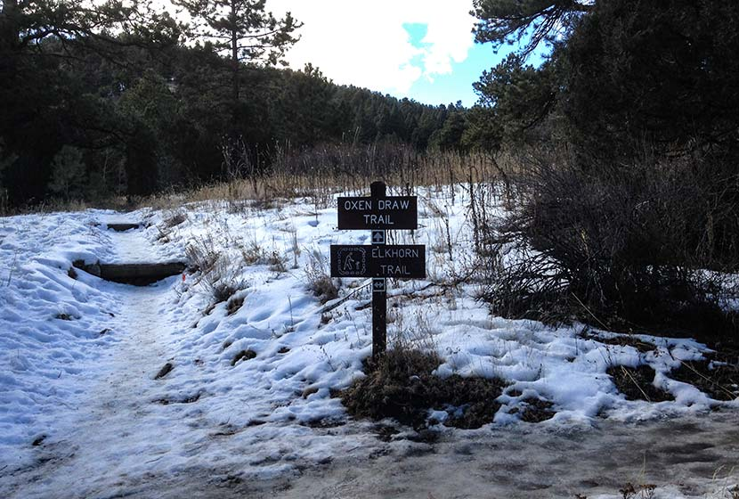 trail for eagles view loop with signs and snow on ground at reynolds park colorado