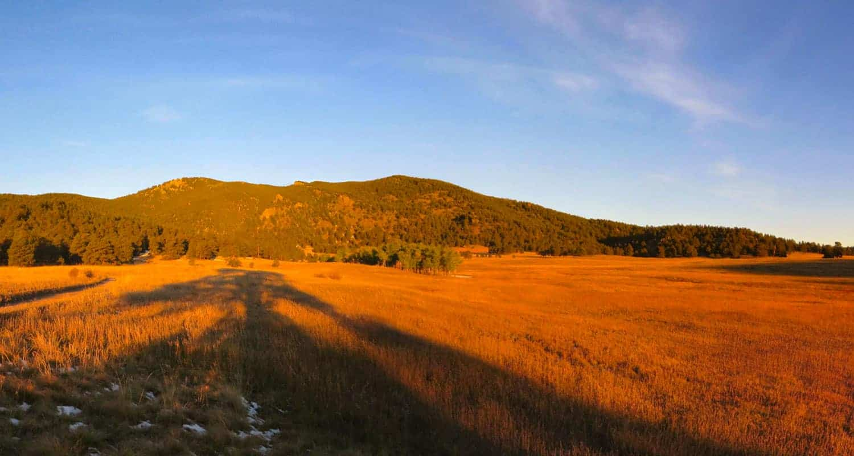sunrise on bergen peak hike near evergreen colorado with elk meadows in foreground and bergen peak in background
