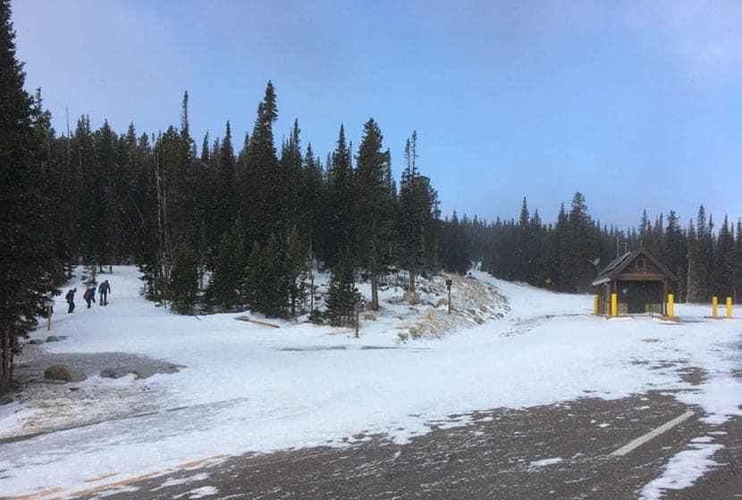 snowshoers on trail at beginning of snowshoe trail brainard lake colorado