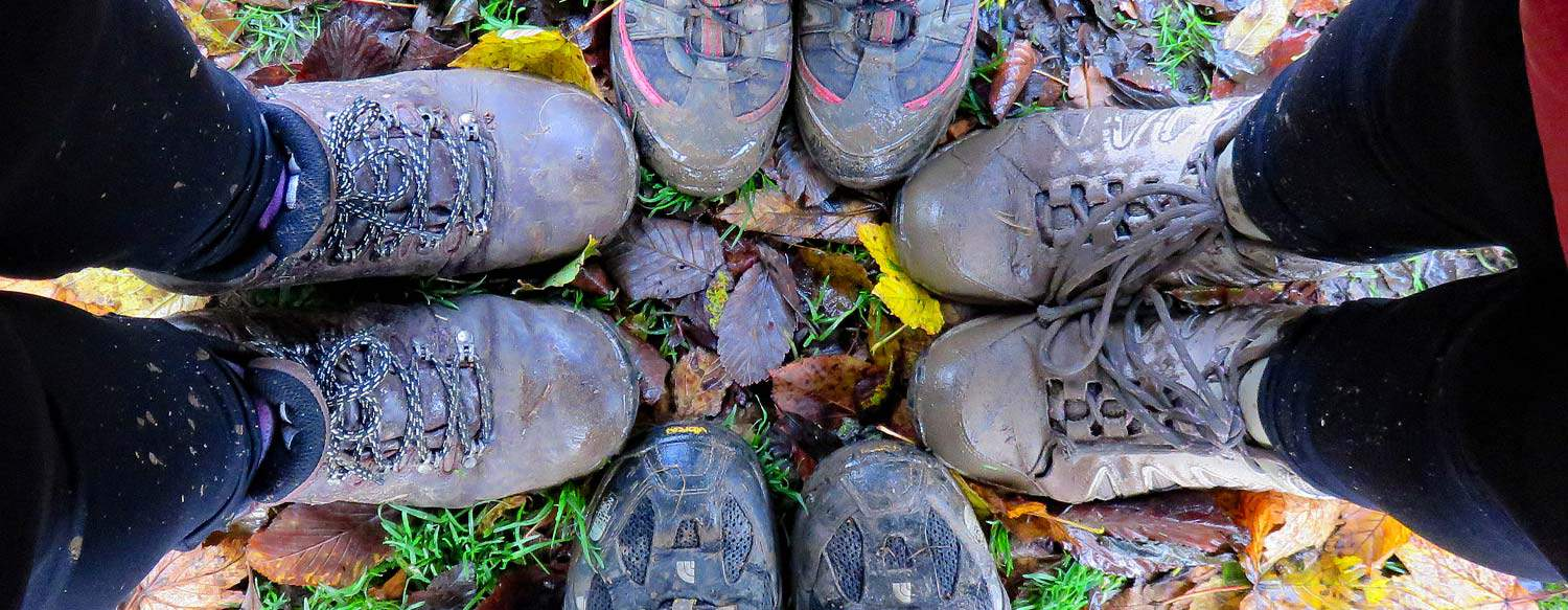 hikers with muddy hiking boots tips for hiking muddy trails