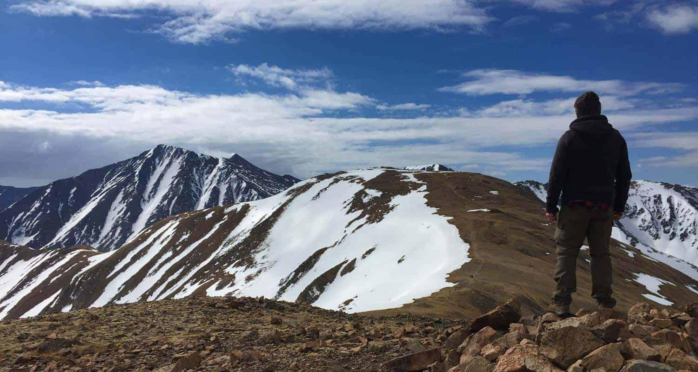 hiker looking toward grizzly peak near loveland pass colorado